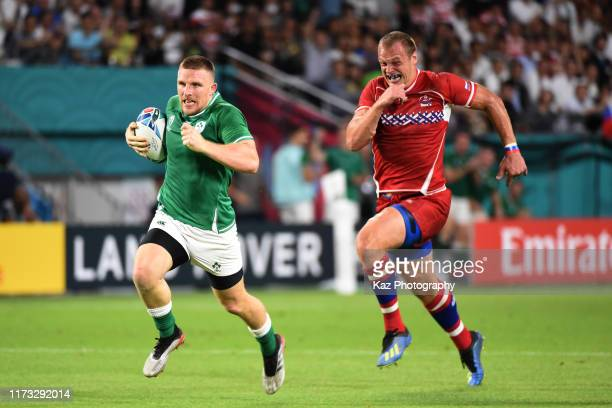 Andrew Conway of Ireland runs with the ball for 4th try during the Rugby World Cup 2019 Group A game between Ireland and Russia at Kobe Misaki...