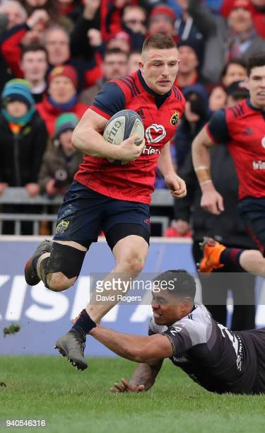 Andrew Conway of Munster breaks clear to score crucial late second half try during the European Rugby Champions Cup match between Munster Rugby and...