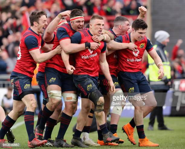 Andrew Conway of Munster celebrates with team mate and the crowd after scoring a crucial late second half try during the European Rugby Champions Cup...