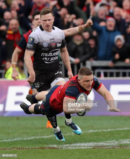 Andrew Conway of Munster dives for a late second half try during the European Rugby Champions Cup match between Munster Rugby and RC Toulon at...