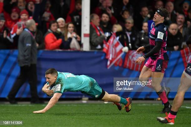 Andrew Conway of Munster dives in to score a try during the Champions Cup match between Gloucester Rugby and Munster Rugby at Kingsholm Stadium on...