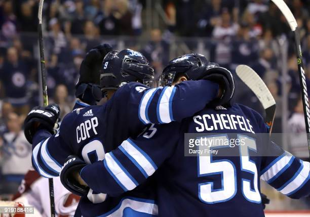 Andrew Copp and Mark Scheifele of the Winnipeg Jets celebrate a second period goal against the Colorado Avalanche with teammates at the Bell MTS...
