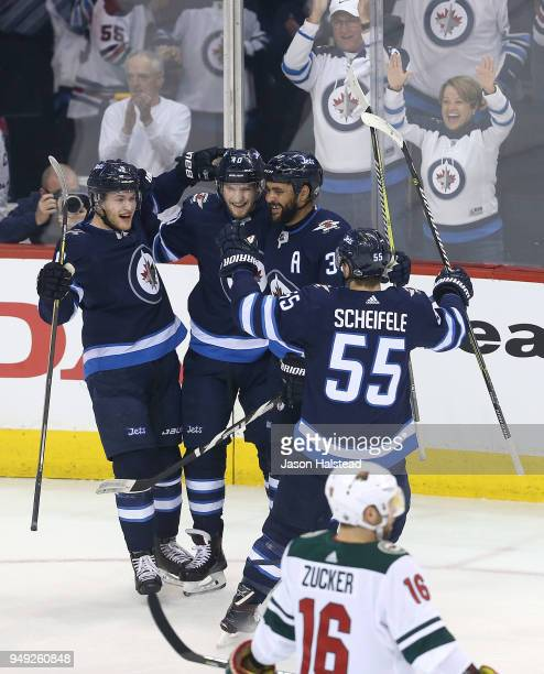 Andrew Copp Dustin Byfuglien Mark Scheifele and Joel Armia of the Winnipeg Jets celebrate Armia's goal in Game Five of the Western Conference First...