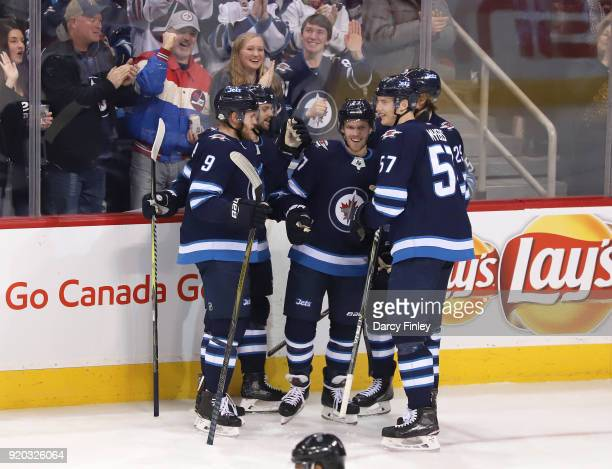 Andrew Copp Josh Morrissey Nikolaj Ehlers Tyler Myers and Patrik Laine of the Winnipeg Jets celebrate a second period goal against the Florida...