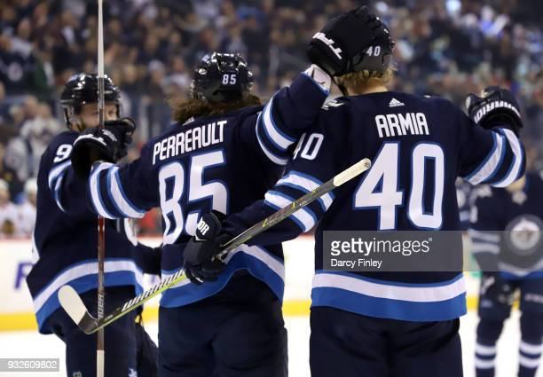 Andrew Copp Mathieu Perreault and Joel Armia of the Winnipeg Jets celebrate a first period goal against the Chicago Blackhawks at the Bell MTS Place...