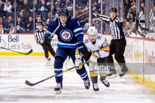 Andrew Copp of the Winnipeg Jets and Jonathan Marchessault of the Vegas Golden Knights battle as they follow the play down the ice during second...
