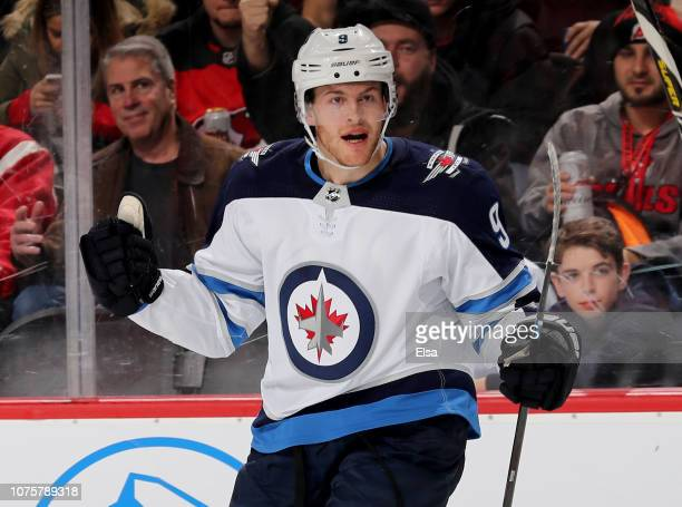 Andrew Copp of the Winnipeg Jets celebrates a goal in the third period against the New Jersey Devils at Prudential Center on December 01 2018 in...