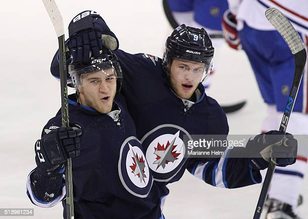 Andrew Copp of the Winnipeg Jets celebrates his goal with teammate JC Lipon in third period action in an NHL game against the Montreal Canadiens at...
