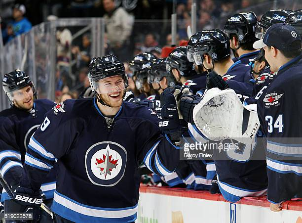 Andrew Copp of the Winnipeg Jets celebrates his third period goal against the Minnesota Wild with teammates at the bench at the MTS Centre on April 3...
