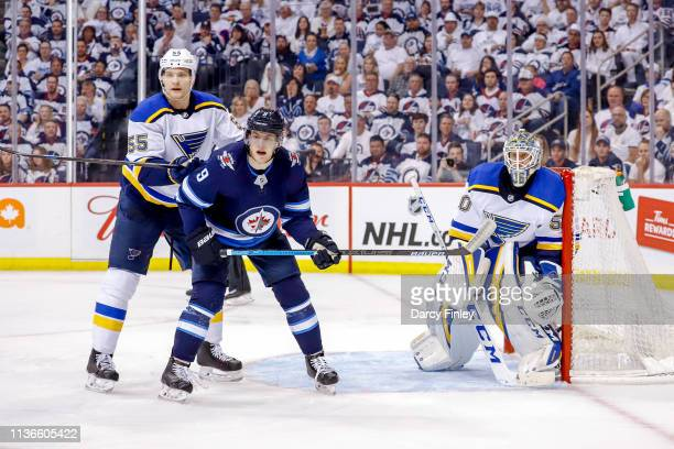 Andrew Copp of the Winnipeg Jets Colton Parayko and goaltender Jordan Binnington of the St Louis Blues keep an eye on the play during third period...
