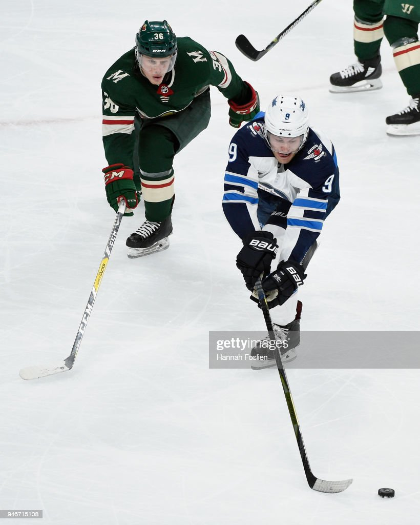 Andrew Copp #9 of the Winnipeg Jets controls the puck against Nick Seeler #36 of the Minnesota Wild during the third period in Game Three of the Western Conference First Round during the 2018 NHL Stanley Cup Playoffs at Xcel Energy Center on April 15, 2018 in St Paul, Minnesota. The Wild defeated the Jets 6-2.