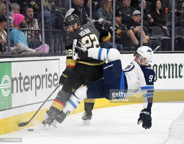 Andrew Copp of the Winnipeg Jets falls after trying to check Nick Holden of the Vegas Golden Knights in the first period of their game at TMobile...
