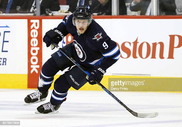 Andrew Copp of the Winnipeg Jets follows the play down the ice during first period action against the New Jersey Devils at the MTS Centre on November...