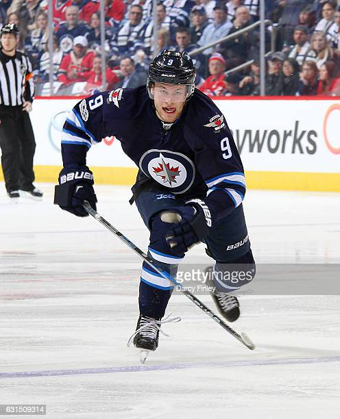 Andrew Copp of the Winnipeg Jets follows the play down the ice during first period action against the Montreal Canadiens at the MTS Centre on January...