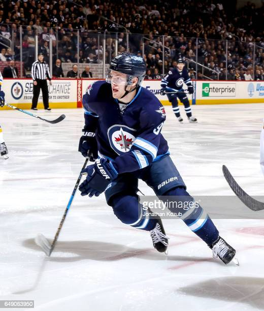 Andrew Copp of the Winnipeg Jets follows the play down the ice during second period action against the St Louis Blues at the MTS Centre on March 3...