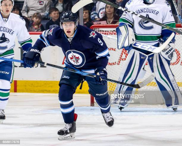 Andrew Copp of the Winnipeg Jets follows the play down the ice during first period action against the Vancouver Canucks at the MTS Centre on March 26...