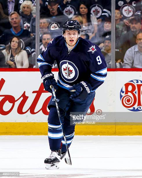 Andrew Copp of the Winnipeg Jets follows the play up the ice during first period action against the Los Angeles Kings at the MTS Centre on October 27...