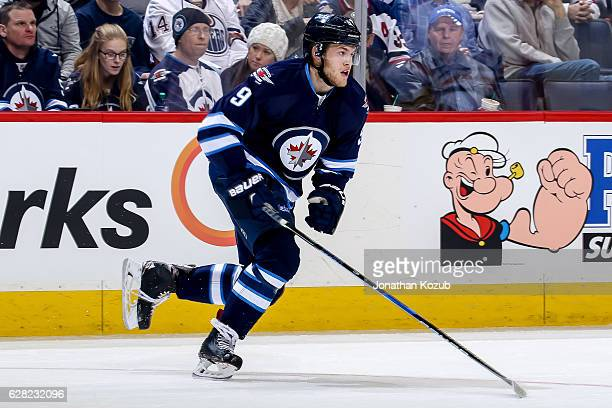 Andrew Copp of the Winnipeg Jets follows the play up the ice during first period action against the Edmonton Oilers at the MTS Centre on December 1...