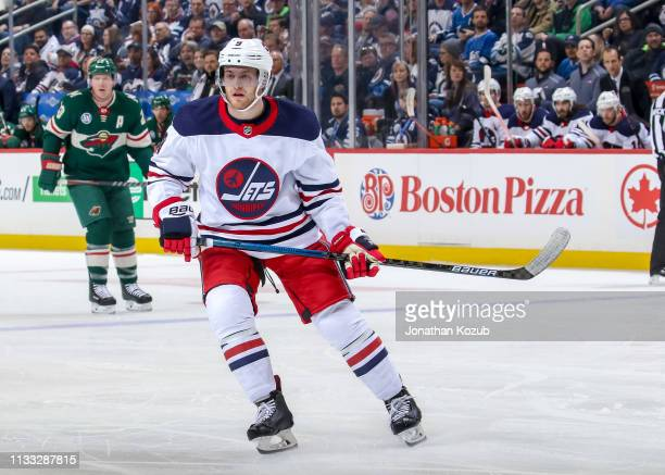 Andrew Copp of the Winnipeg Jets keeps an eye on the play during first period action against the Minnesota Wild at the Bell MTS Place on February 26...