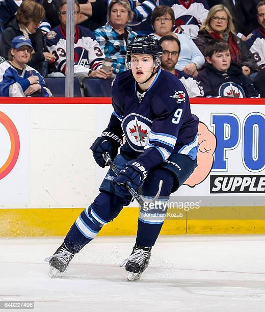 Andrew Copp of the Winnipeg Jets keeps an eye on the play during first period action against the San Jose Sharks at the MTS Centre on January 24 2017...
