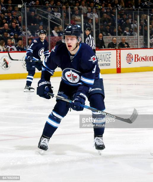 Andrew Copp of the Winnipeg Jets keeps an eye on the play during second period action against the St Louis Blues at the MTS Centre on March 3 2017 in...