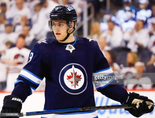 Andrew Copp of the Winnipeg Jets looks on during a third period stoppage in play against the St Louis Blues in Game Two of the Western Conference...