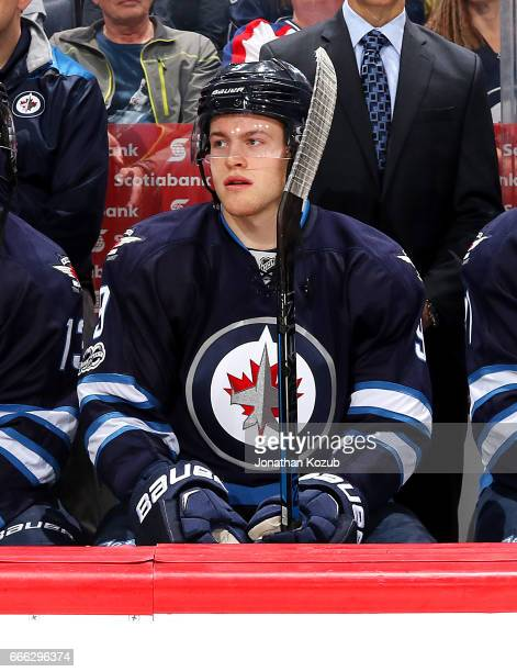 Andrew Copp of the Winnipeg Jets looks on from the bench prior to puck drop against the Nashville Predators at the MTS Centre on April 8 2017 in...