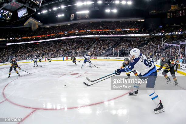 Andrew Copp of the Winnipeg Jets passes the puck across the ice during third period action against the Vegas Golden Knights at TMobile Arena on...
