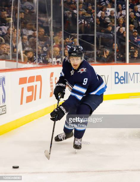 Andrew Copp of the Winnipeg Jets plays the puck around the boards during second period action against the St Louis Blues at the Bell MTS Place on...