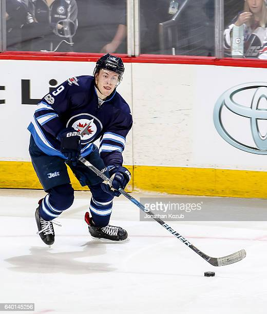 Andrew Copp of the Winnipeg Jets plays the puck during third period action against the Anaheim Ducks at the MTS Centre on January 23 2017 in Winnipeg...