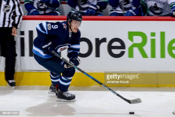 Andrew Copp of the Winnipeg Jets plays the puck up the ice during second period action against the Vancouver Canucks at the Bell MTS Place on...
