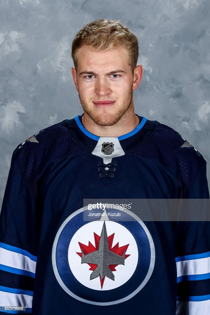 Andrew Copp of the Winnipeg Jets poses for his official headshot for the 2017-2018 season on September 14, 2017 at the Bell MTS Iceplex in Winnipeg, Manitoba, Canada.