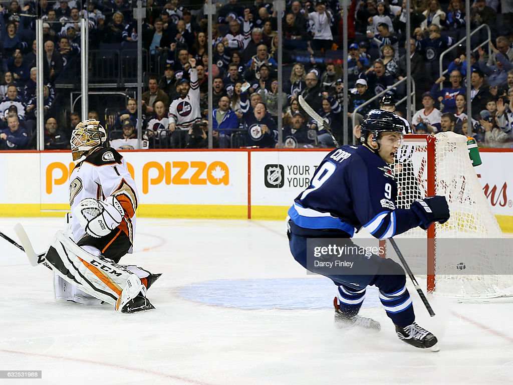 Andrew Copp #9 of the Winnipeg Jets reacts after scoring a first period goal against goaltender Jonathan Bernier #1 of the Anaheim Ducks at the MTS Centre on January 23, 2017 in Winnipeg, Manitoba, Canada.