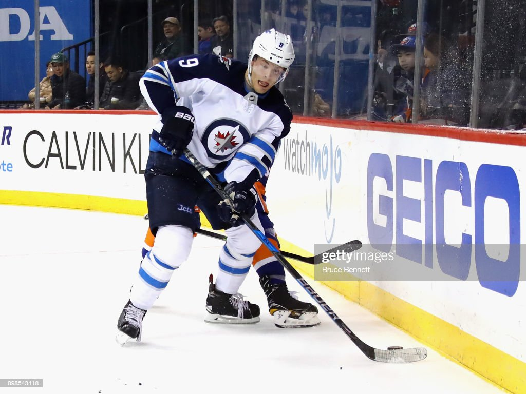 Andrew Copp #9 of the Winnipeg Jets skates against the New York Islanders at the Barclays Center on December 23, 2017 in the Brooklyn borough of New York City. The Islanders defeated the Jets 5-2.