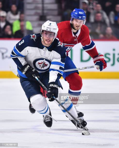 Andrew Copp of the Winnipeg Jets skates the puck against the Montreal Canadiens during the NHL game at the Bell Centre on February 7 2019 in Montreal...