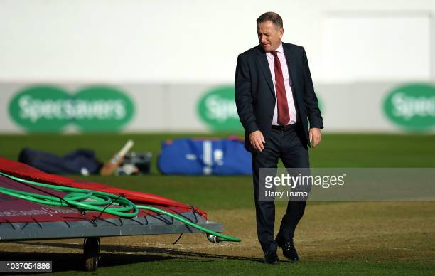 Andrew Cornish CEO of Somerset inspects the pitch as strong winds and heavy rain force a section of the covers to blow off and damage the pitch...