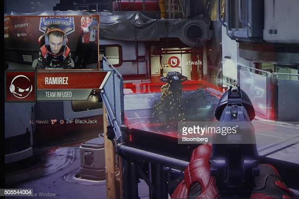Andrew Corrigan a professional videogame player also known as Ramirez of team Infused is inset on a screen showing video game play during the third...
