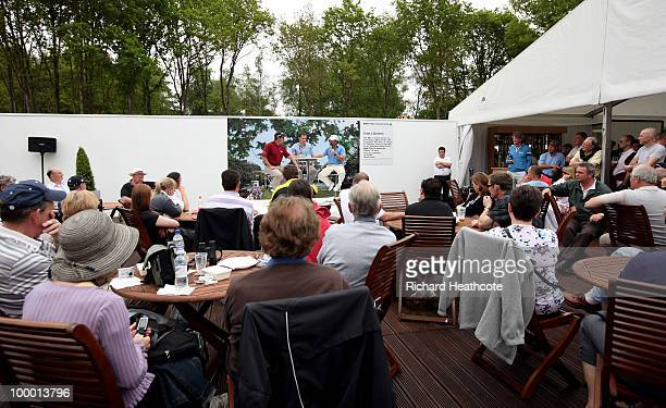 Andrew Cotter of the BBC asks questions to tour players David Howell of England and Graeme McDowell of Northern Ireland during an informal QA session...