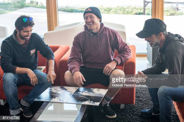 Andrew Cotton and some friends looks for the sequence of images of the wave that he surfed on November 8th at Praia do Norte at Nazare and that...