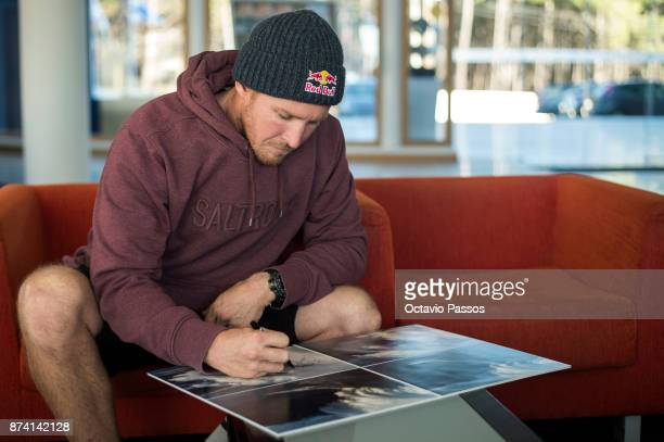 Andrew Cotton looks and signs the sequence of images of the wave that he surfed on November 8th at Praia do Norte at Nazare where he suffered his...