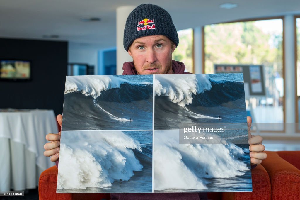 Andrew Cotton poses for the photograph, holding the sequence of images of the wave that he surfed on November 8th at Praia do Norte at Nazare where he suffered his accident, on November 14, 2017 in Nazare, Portugal. Andrew Cotton, 36, from Braunton, Devon in the UK, fractured his vertbra L2 after wiping out surfing the giant waves at Nazare Portugal. He was filming a documentary on Wednesday 8th November 2017.