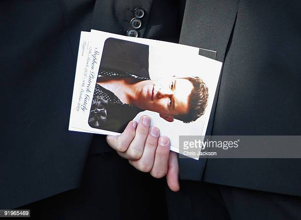 Andrew Cowles holds an order of service as he attends the funeral of Boyzone singer Stephen Gately at St Laurence O'Toole Church on October 17 2009...