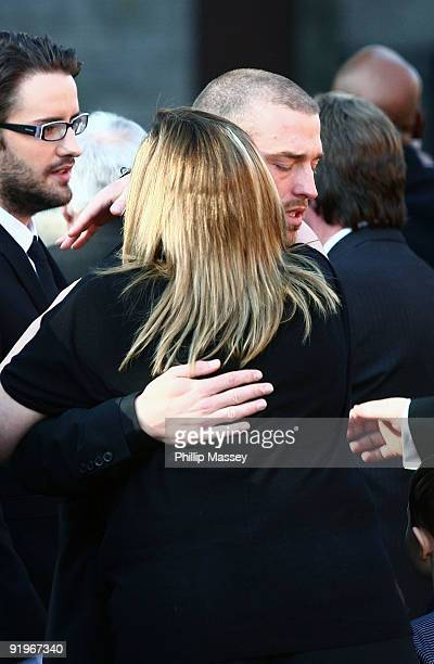 Andrew Cowles is comforted at the funeral of Boyzone member Stephen Gately on October 17 2009 in Dublin Ireland