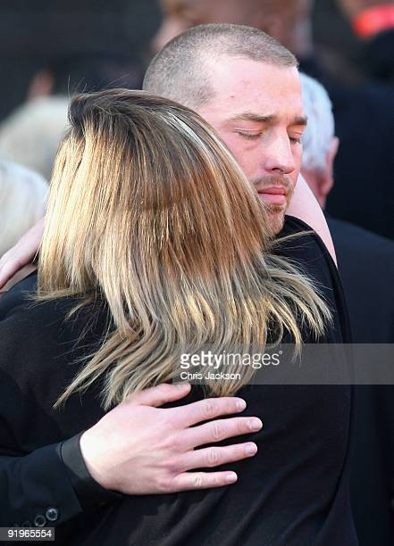 Andrew Cowles is comforted by friends as he attends the funeral of Boyzone singer Stephen Gately at St Laurence O'Toole Church on October 17 2009 in...