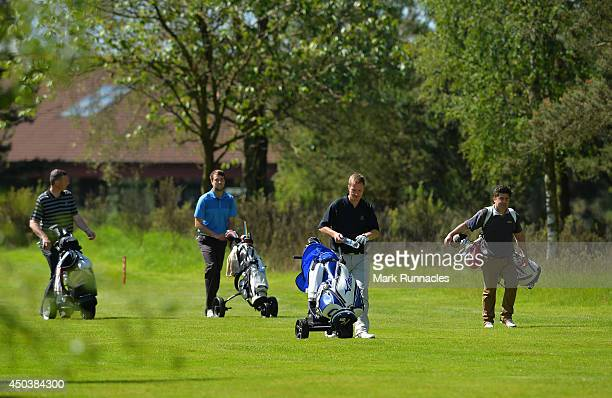 Andrew Crerar and Graig McKinlay of Panmure Golf Club walking to the 10th green followed by Martyn Huish and Alastair Simpson of North Berwick Golf...
