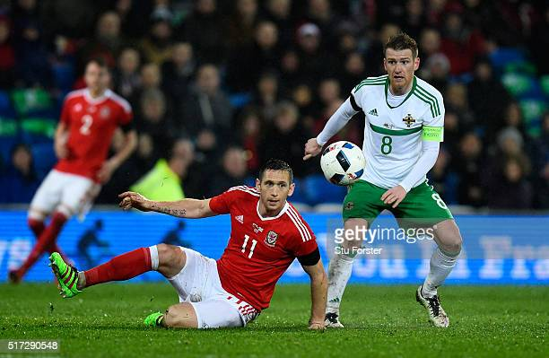 Andrew Crofts of Wales and Steven Davis of Northern Ireland compete for the ball during the international friendly match between Wales and Northern...