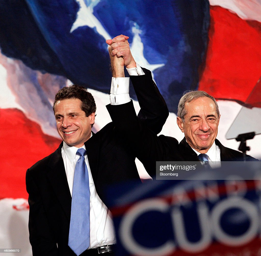 Andrew Cuomo, attorney general-elect, left, and his father Mario Coumo, former Governor of New York, celebrate at a victory party in New York, U.S., on Tuesday, Nov. 7, 2006. Mario Cuomo, the silver-tongued, three-term New York governor who twice declined entreaties to run for president, has died. He was 82. Photographer: David Karp/Bloomberg via Getty Images