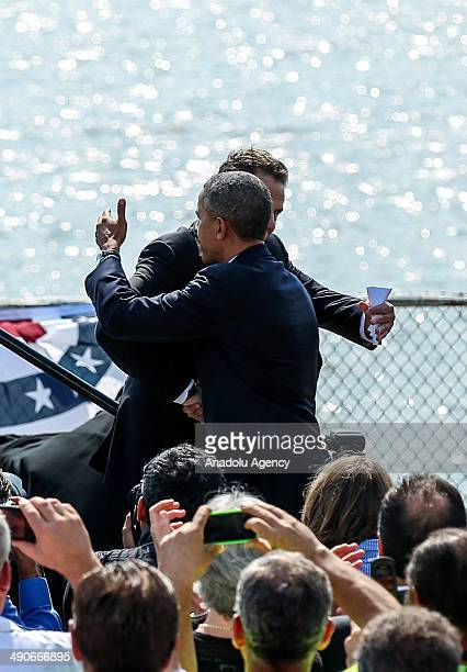 Andrew Cuomo Governor of New York and US President Barack Obama shake hands at the Washington Irving Boat Club in New York United States on May 14...