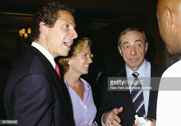Andrew Cuomo his wife Kerry KennedyCuomo and father former Gov Mario Cuomo chat with actor Russell Simmons during a reception for Andrew and Kerry...