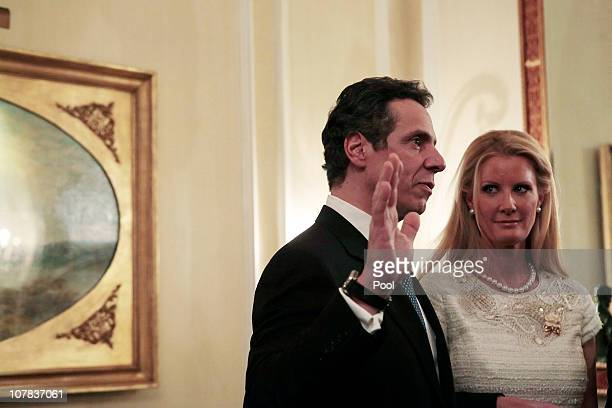 Andrew Cuomo is sworn in as Governor of New York at the Executive Mansion by Chief Judge of the Court of Appeals Jonathan Lippman as his girlfriend...